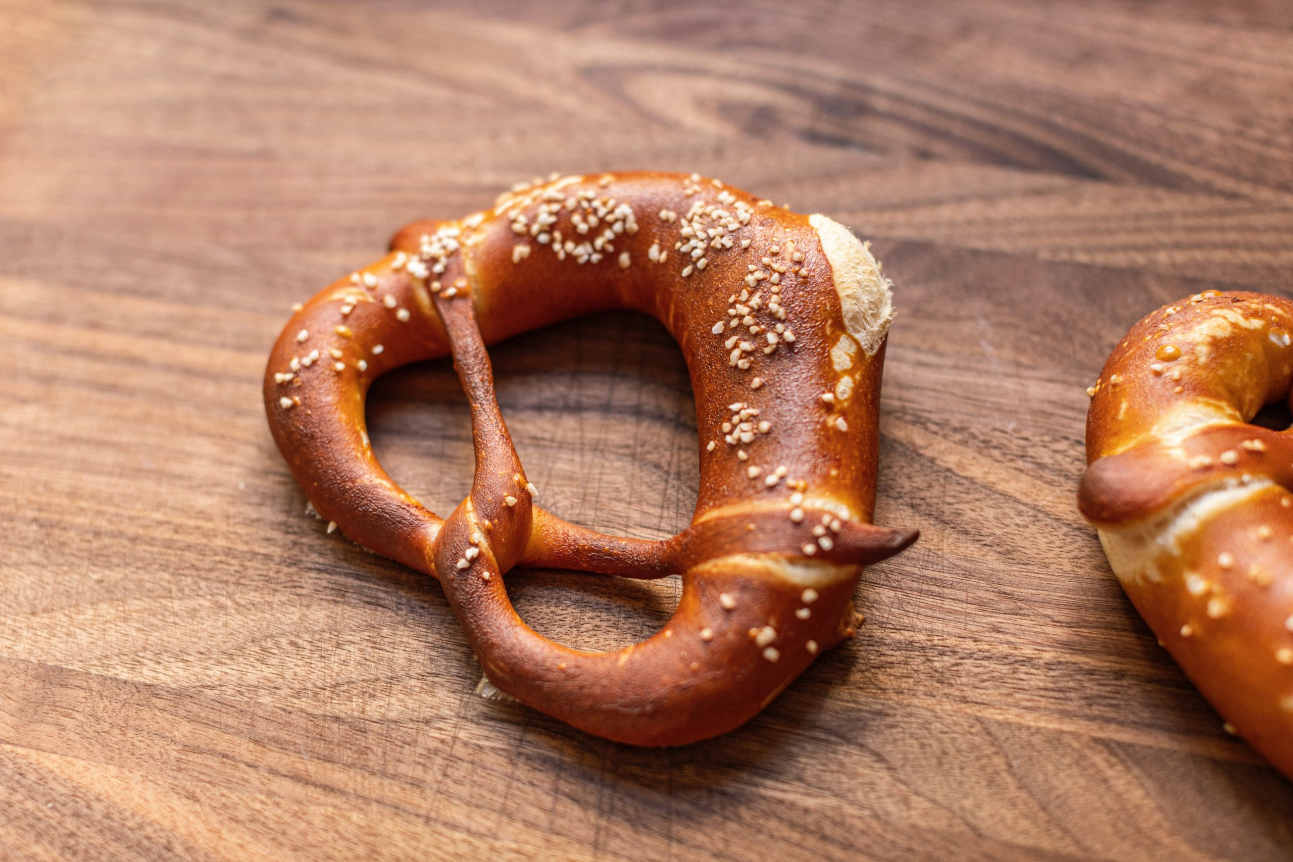A soft pretzel on a table.