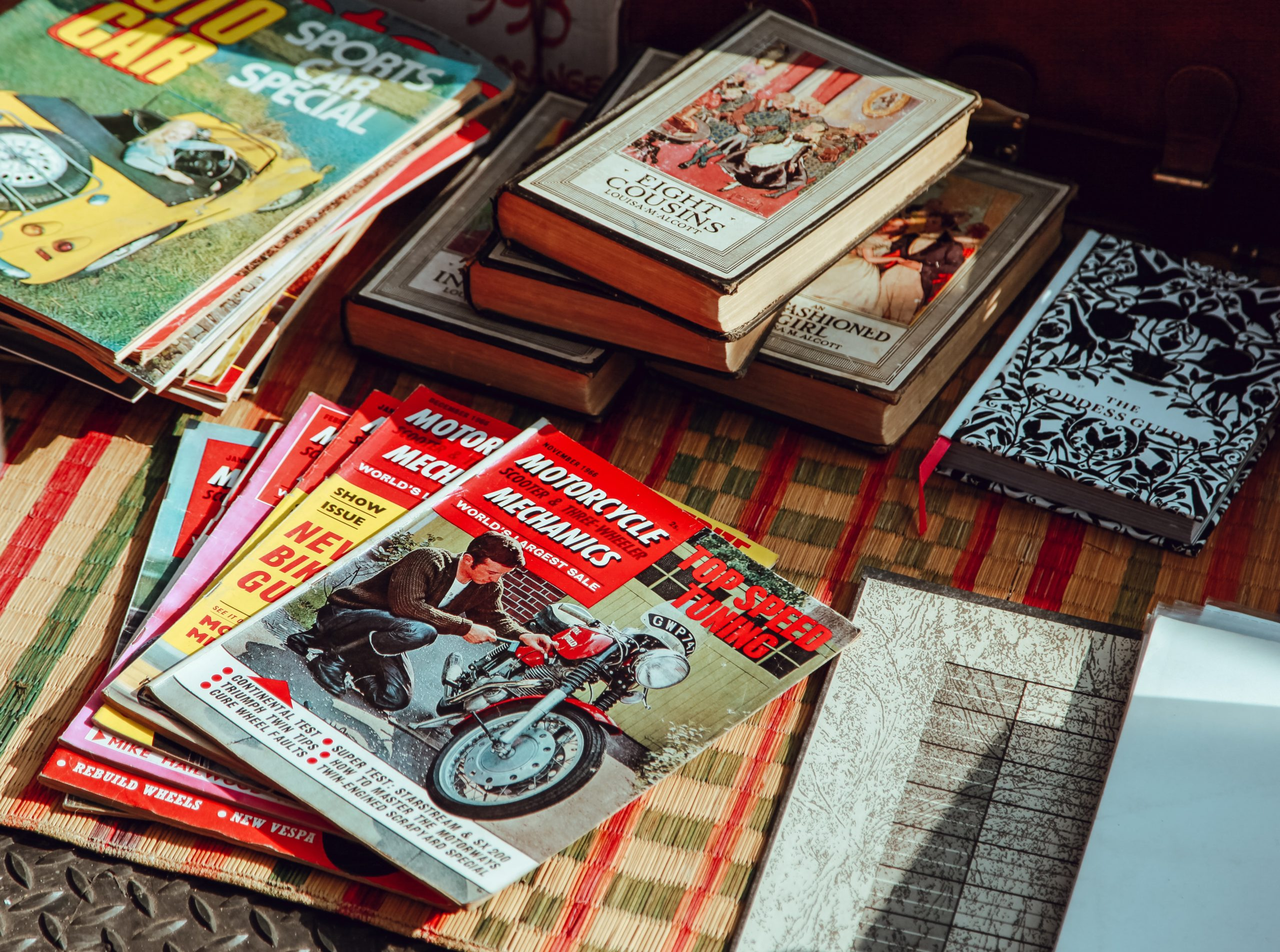 Assorted comic books and graphic novels on a table.