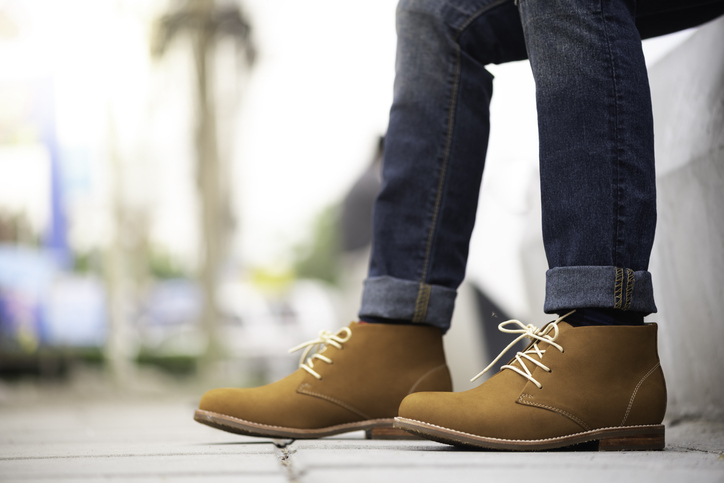 Close up shot of someone wearing new jeans and boots from Germantown brands