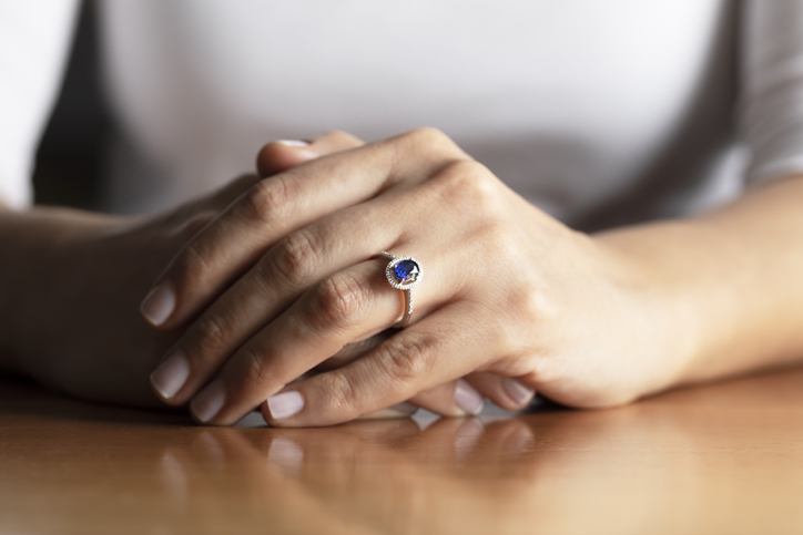 Folded hands with sapphire ring | Jewelry stores near Germantown