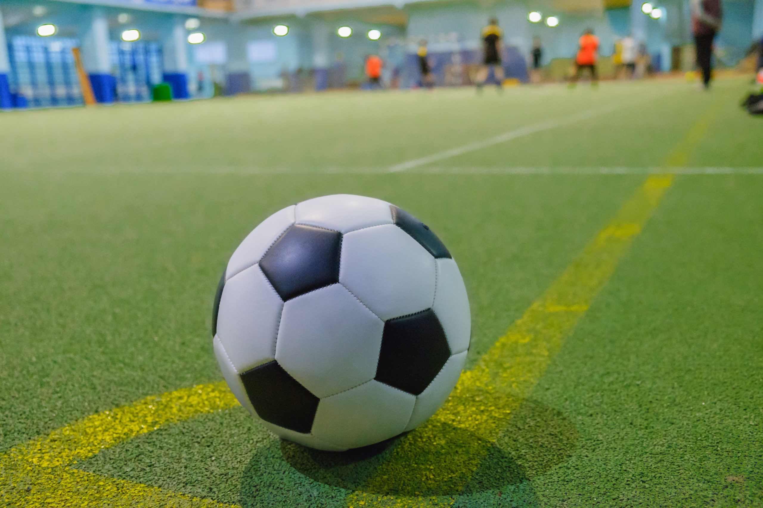 A close up of a soccer ball on an indoor field | indoor soccer near Germantown