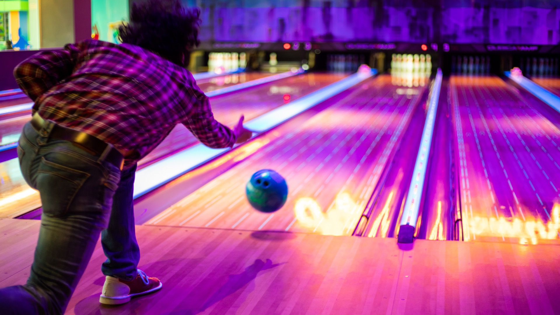 Person bowling | Bowling alleys around Germantown